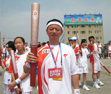 The torch Guang hongguang: enhancing the economic strength of support undertakings of physical cultu